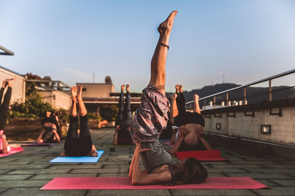 Things to know before going on a Yoga retreat - woman headstand pose