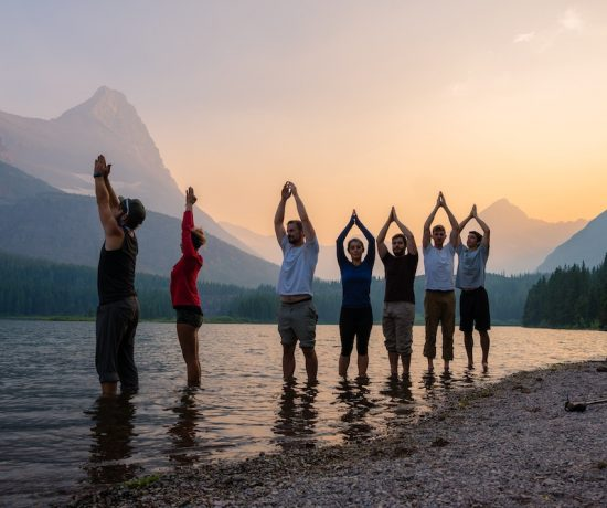 Yoga retreats in the USA with people at the beach