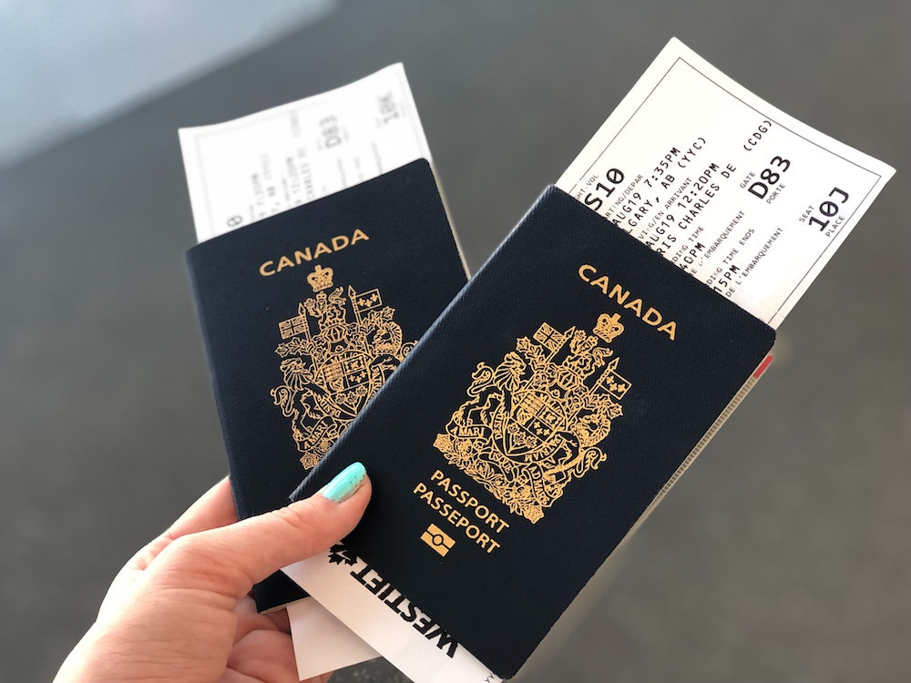 Two passports with flight tickets