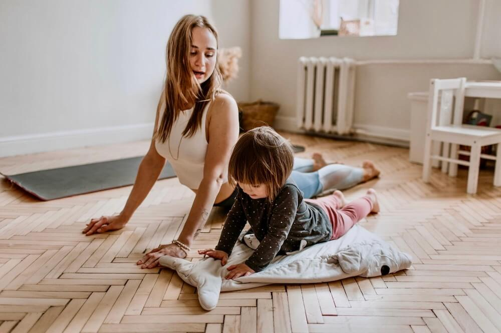 Woman doing yoga with her son