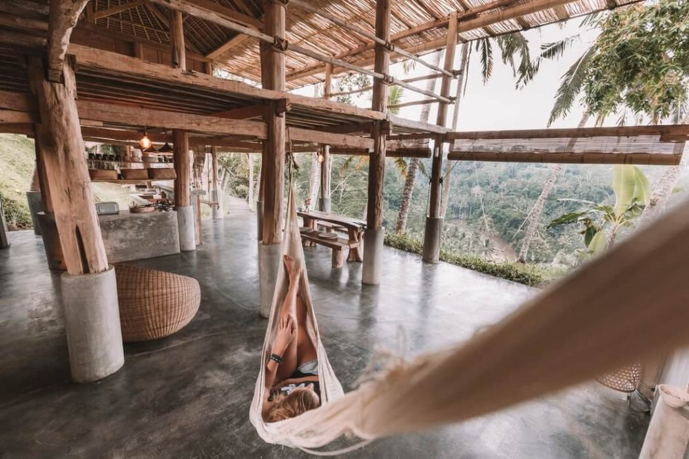 Woman in a hammock - Signs you need to go on a yoga retreat