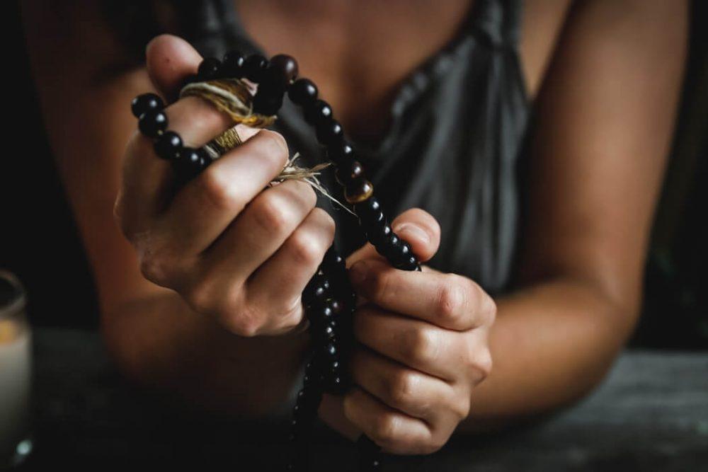 Woman holding a Mala