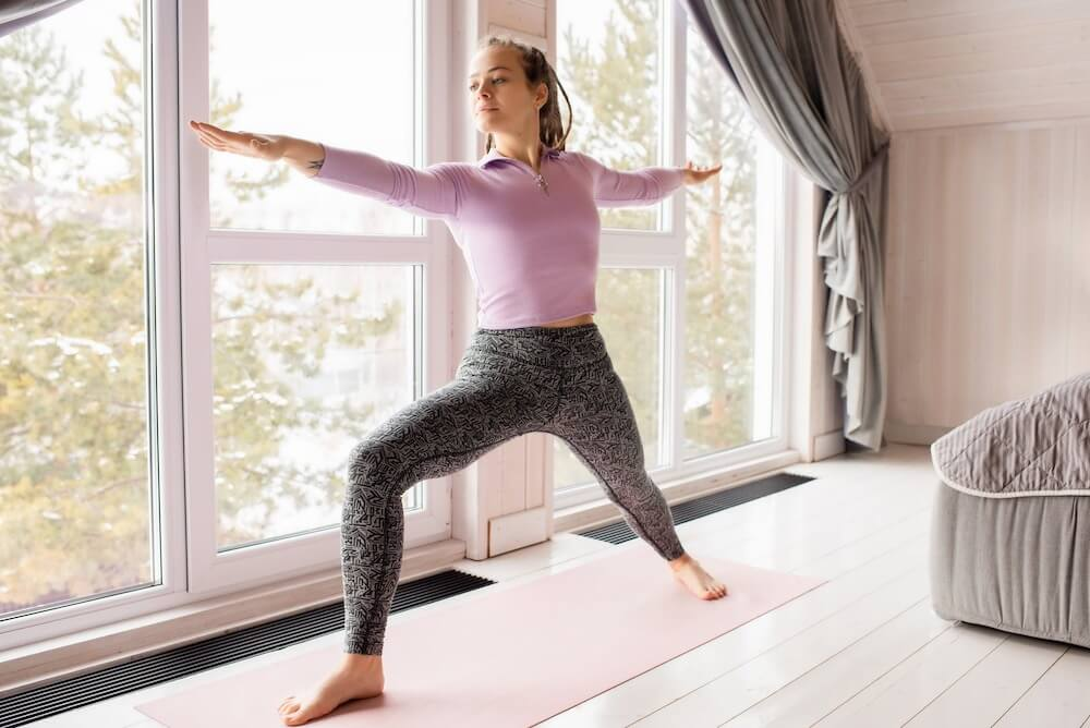 Woman holding a yoga pose at home