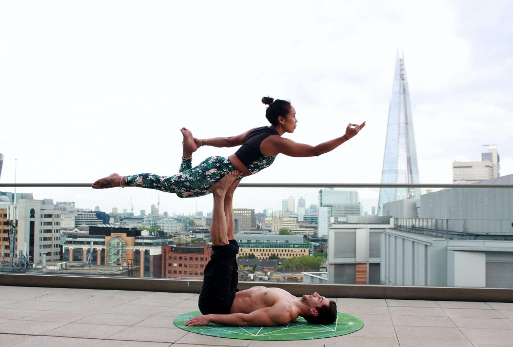 Couple on a terrace doing yoga