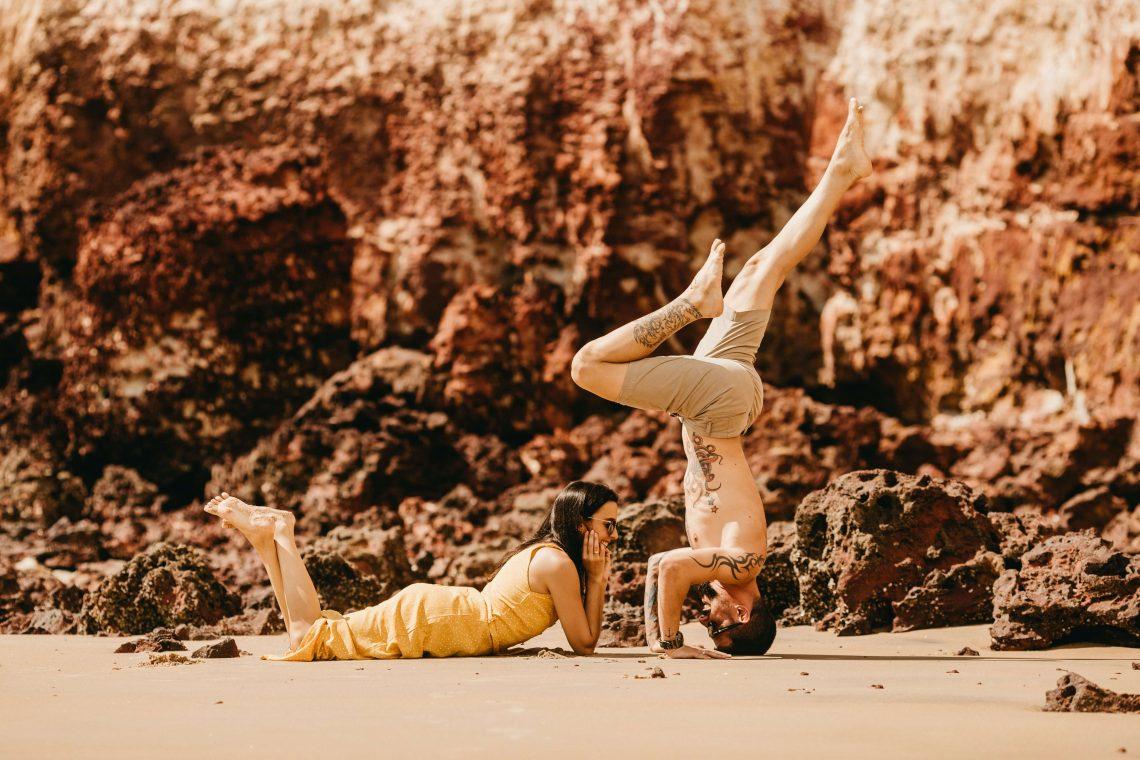 Banner couple yoga retreat - A couple doing a yoga pose