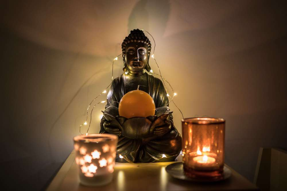 Buddha and candles - yoga retreat home